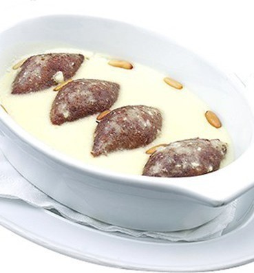 Kubbeh in yogurt sauce